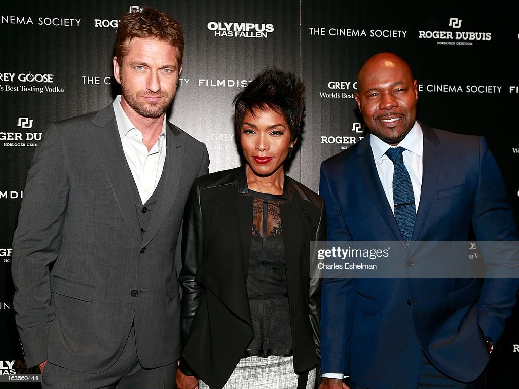 Actors Gerard Butler, Angela Bassett and director Antoine Fuqua attend The Cinema Society with Roger Dubuis and Grey Goose screening of FilmDistrict's 'Olympus Has Fallen' at the Tribeca Grand Screening Room on March 11, 2013 in New York City.