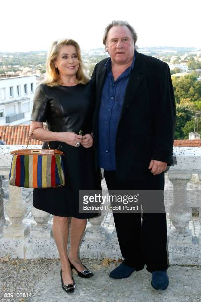 Actors Gerard Depardieu and Catherine Deneuve attend the 'Bonne Pomme' movie Photocall during the 10th Angouleme FrenchSpeaking Film Festival Day...