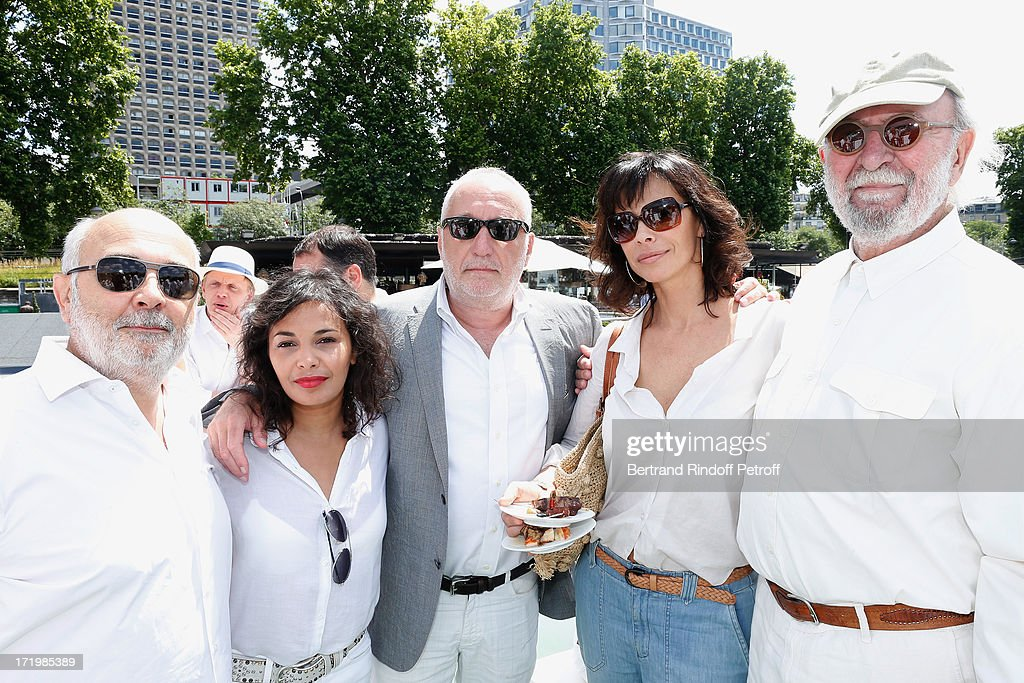 Actors Gerard Jugnot with his companion <a gi-track='captionPersonalityLinkClicked' href=/galleries/search?phrase=Saida+Jawad&family=editorial&specificpeople=6370677 ng-click='$event.stopPropagation()'>Saida Jawad</a>, <a gi-track='captionPersonalityLinkClicked' href=/galleries/search?phrase=Francois+Berleand&family=editorial&specificpeople=575825 ng-click='$event.stopPropagation()'>Francois Berleand</a>, <a gi-track='captionPersonalityLinkClicked' href=/galleries/search?phrase=Mathilda+May&family=editorial&specificpeople=688986 ng-click='$event.stopPropagation()'>Mathilda May</a> and <a gi-track='captionPersonalityLinkClicked' href=/galleries/search?phrase=Jean-Pierre+Marielle&family=editorial&specificpeople=573642 ng-click='$event.stopPropagation()'>Jean-Pierre Marielle</a> attend 'Brunch Blanc' hosted by Groupe Barriere for Sodexho with a cruise in Paris on June 30, 2013, France.
