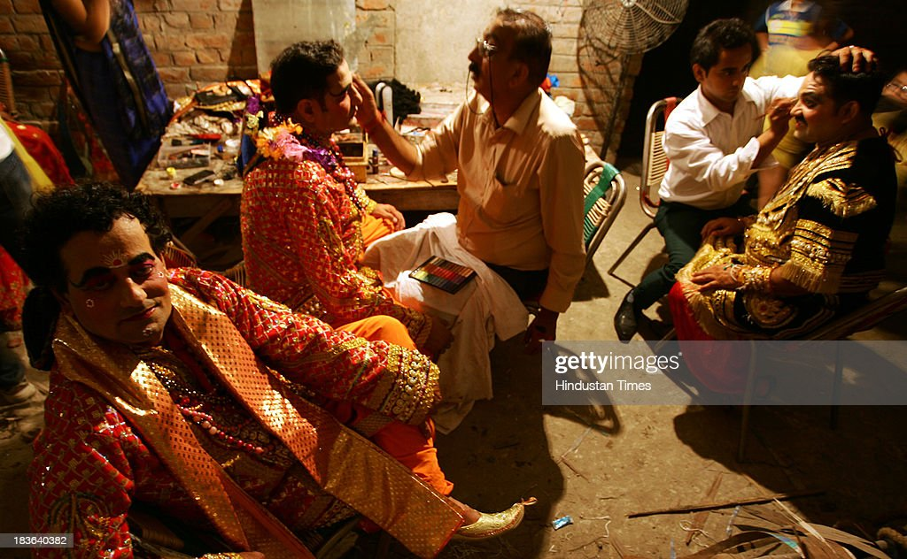 Actors get ready as they prepares backstage for a performance of the Ramlila on October 7, 2013 in Jammu, India. Ramlila is a dramatic folk re-enactment of the life of Hindu Lord Rama's victory after a ten day battle with the ten headed Demon King Ravana.