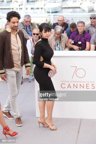 Actors Ghanem Zrelli and Mariam Al Ferjani attend the 'Alaka Kaf Ifrit ' photocall during the 70th annual Cannes Film Festival at Palais des...