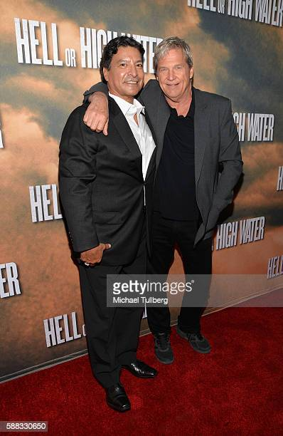 Actors Gil Birmingham and Jeff Bridges arrive at the Los Angeles red carpet screening of 'Hell Or High Water' at ArcLight Hollywood on August 10 2016...