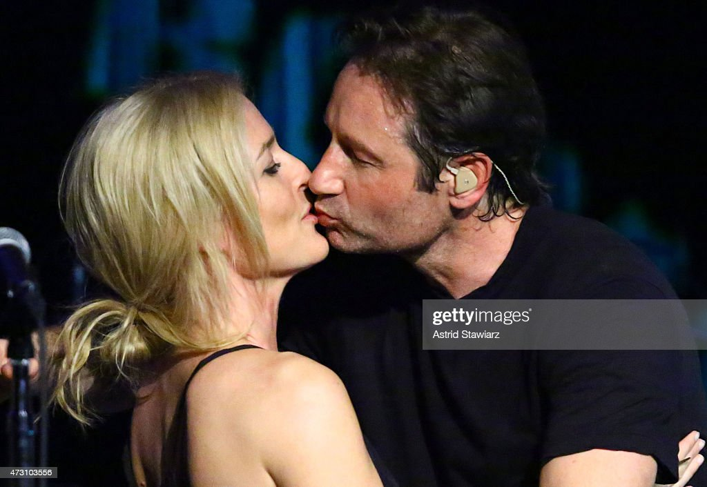 Actors <a gi-track='captionPersonalityLinkClicked' href=/galleries/search?phrase=Gillian+Anderson&family=editorial&specificpeople=202894 ng-click='$event.stopPropagation()'>Gillian Anderson</a> and <a gi-track='captionPersonalityLinkClicked' href=/galleries/search?phrase=David+Duchovny&family=editorial&specificpeople=201628 ng-click='$event.stopPropagation()'>David Duchovny</a> attend <a gi-track='captionPersonalityLinkClicked' href=/galleries/search?phrase=David+Duchovny&family=editorial&specificpeople=201628 ng-click='$event.stopPropagation()'>David Duchovny</a> in concert at The Cutting Room on May 12, 2015 in New York City.
