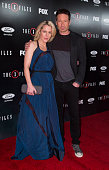 Actors Gillian Anderson and David Duchovny attend the premiere of Fox's 'The XFiles' at California Science Center on January 12 2016 in Los Angeles...