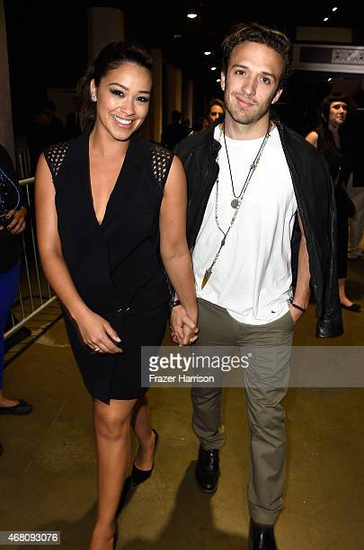Actors Gina Rodriguez and Henri Esteve attend the 2015 iHeartRadio Music Awards which broadcasted live on NBC from The Shrine Auditorium on March 29...