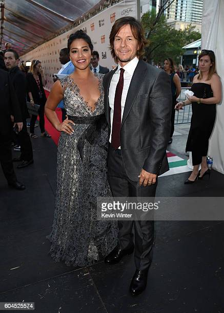 Actors Gina Rodriguez and Mark Wahlberg attend the 'Deepwater Horizon' premiere during the 2016 Toronto International Film Festival at Roy Thomson...
