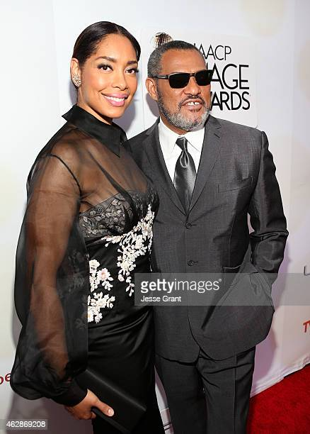 Actors Gina Torres and Laurence Fishburne attend the 46th NAACP Image Awards presented by TV One at Pasadena Civic Auditorium on February 6 2015 in...