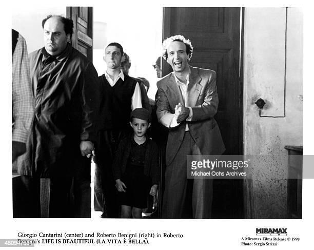 Actors Giorgio Cantarini and Roberto Benigni in a scene from the Miramax movie 'Life Is Beautiful' circa 1997