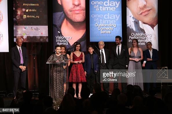 Actors Gloria Calderon Kellett Justina Machado Isabella Gomez Marcel Ruiz Norman Lear Todd Grinnell and Caroline Luich of 'One Day at A Time' onstage...