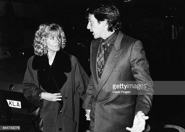 Actors Glynis Barber and Michael Brandon stars of the television show 'Dempsey and Makepeace' arriving to see the musical 'Drood' in London 1987