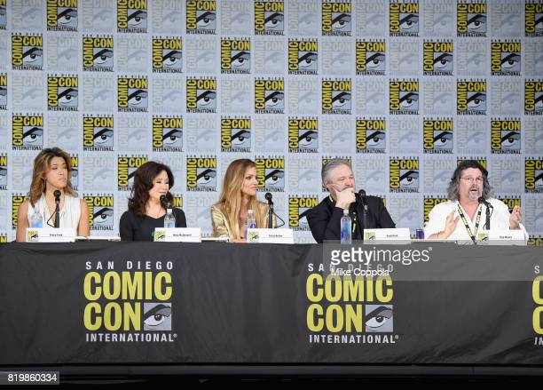 Actors Grace Park Mary McDonnell and Tricia Helfer writers David Eick and Ron Moore speak onstage at SYFY 'Battlestar Galactica' Reunion during...