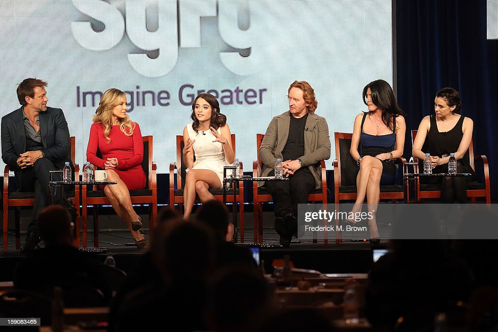 Actors Grant Bowler, Julie Benz, Stephanie Leonidas, Tony Curran, Jaime Murray, and Mia Kirshner speak onstage at the 'Defiance' panel discussion during the Syfy portion of the 2013 Winter TCA Tour- Day 4 at the Langham Hotel on January 7, 2013 in Pasadena, California.