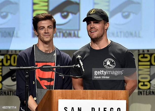 Actors Grant Gustin and Stephen Amell attend Warner Bros Television DC Entertainment world premiere presentation during ComicCon International 2014...