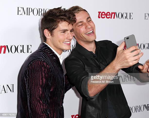 Actors Greg Sulkin and Cameron Fuller attend the Teen Vogue Young Hollywood Party on September 26 2014 in Los Angeles California