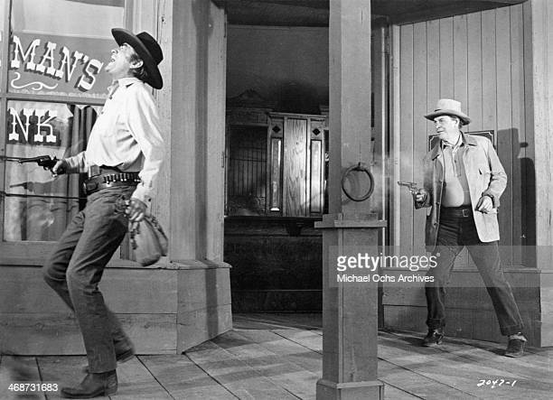 Actors Gregory Peck and James Gregory on set of the movie 'Shoot Out' circa 1971