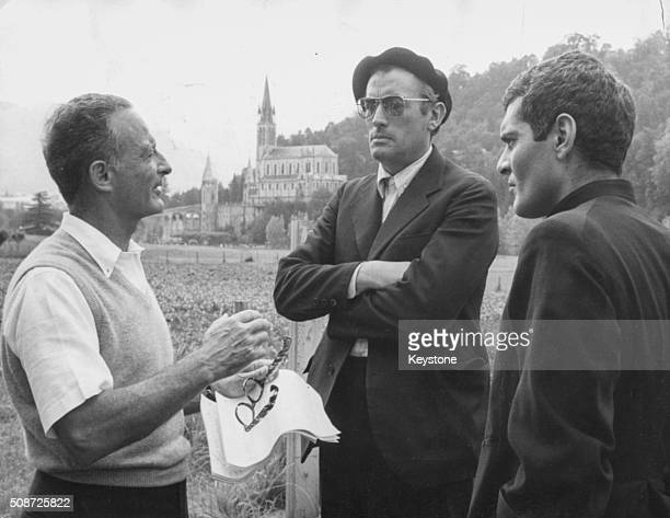 Actors Gregory Peck and Omar Sharif talking to producer Fred Zinnemann as they rehearse a scene for the film 'Behold a Pale Horse' Lourdes July 15th...