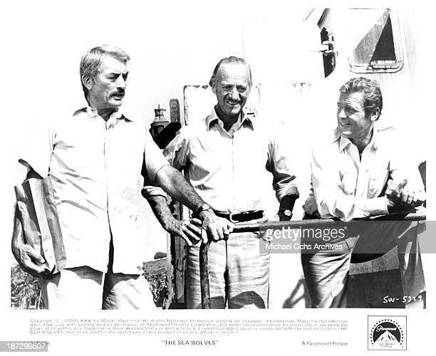 Actors Gregory Peck David Niven and Roger Moore on set of the Paramount Pictures movie 'The Sea Wolves' 1980