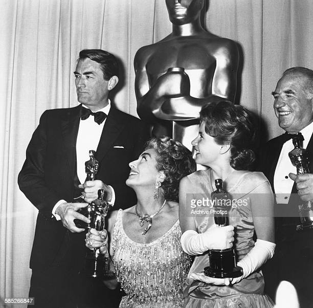 Actors Gregory Peck Joan Crawford Patty Duke And Ed Begley with their Oscars at the 35th Academy Awards Los Angeles April 8th 1963
