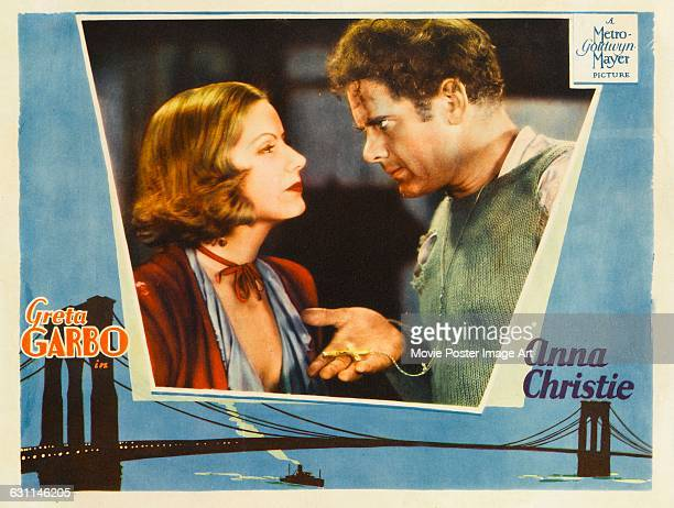 Actors Greta Garbo and Charles Bickford appear on a lobby card for the 1930 film 'Anna Christie' directed by Clarence Brown for MGM