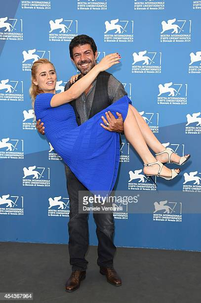 Actors Greta Scarano and Pierfrancesco Favin attend the 'Senza Nessuna Pieta' photocall during the 71st Venice Film Festival on August 30 2014 in...
