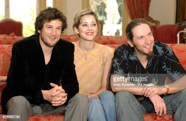 actors Guillaume Canet and Marion Cotillard with director Yann Samuell during a photocall to launch the 2004 Renault French Film Season at the French...