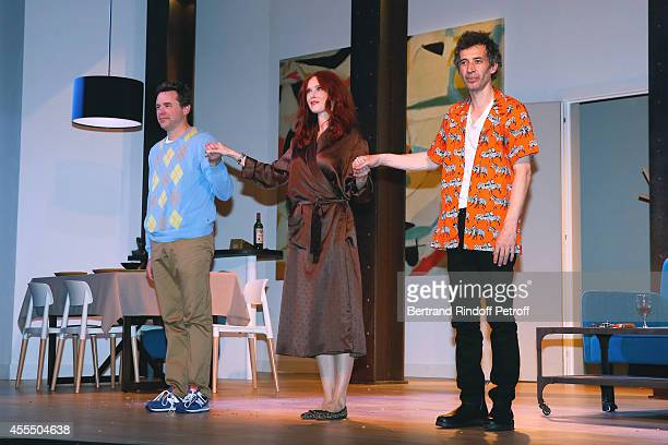 Actors Guillaume de Tonquedec Audrey Fleurot and Eric Elmosnino acknowledge the applause of the audience at the end of 'Un diner d'adieu' Premiere...