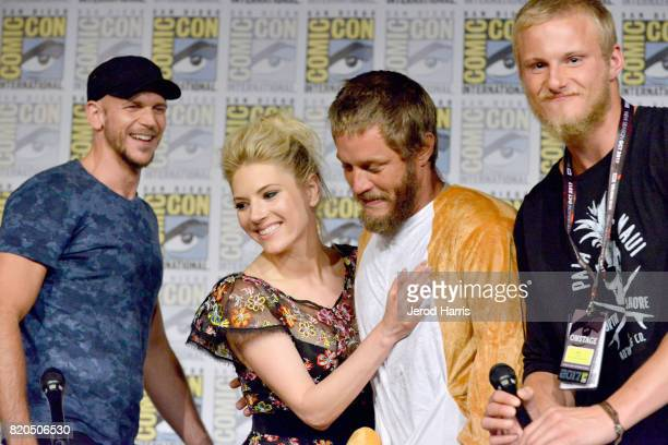Actors Gustaf Skarsgard Katheryn Winnick Travis Fimmel and Alexander Ludwig attend the 'Vikings' panel during San Diego ComicCon International 2017...