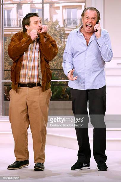 Actors Guy Lecluyse and Michel Leeb perform in 'Le Tombeur' Theater Play at Theatre des Nouveautes on January 21 2015 in Paris France