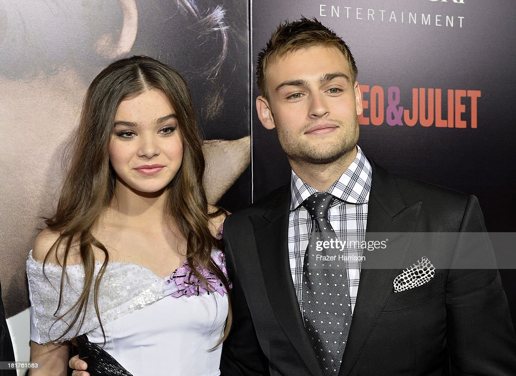 Actors Hailee Steinfeld (L) and Douglas Booth arrive at the premiere of Relativity Media's 'Romeo And Juliet' at ArcLight Cinemas on September 24, 2013 in Hollywood, California.
