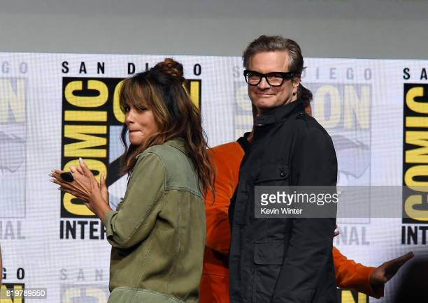 Actors Halle Berry and Colin Firth walk onstage at the 20th Century FOX panel during ComicCon International 2017 at San Diego Convention Center on...