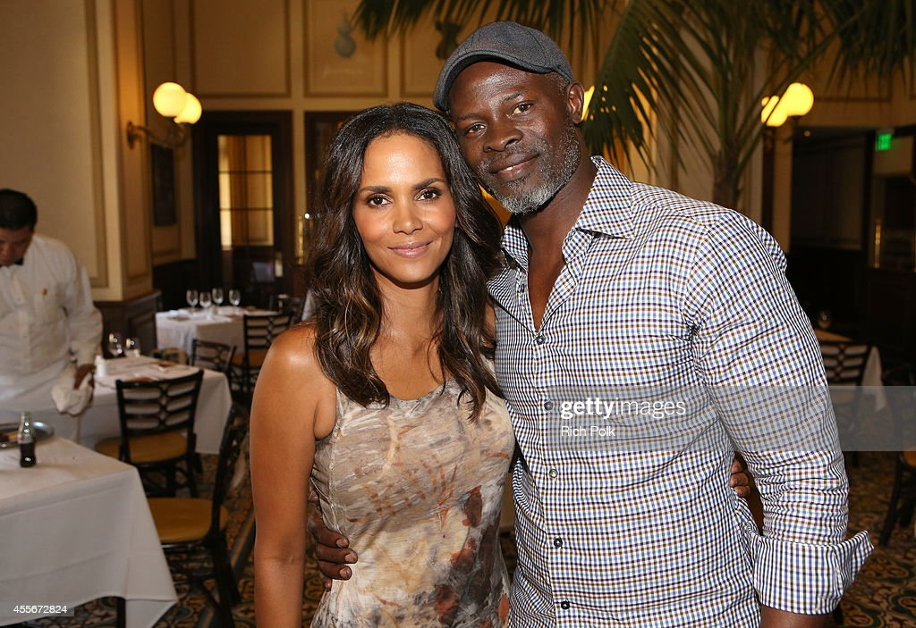 Actors Halle Berry and Djimon Hounsou attend CAA's School Day Benefiting Communities In Schools of Los Angeles at Bouchon on September 18 2014 in...