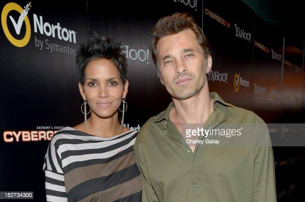 Actors Halle Berry and Olivier Martinez attend the 'Cybergeddon' Premiere at Pacific Design Center on September 24 2012 in West Hollywood California