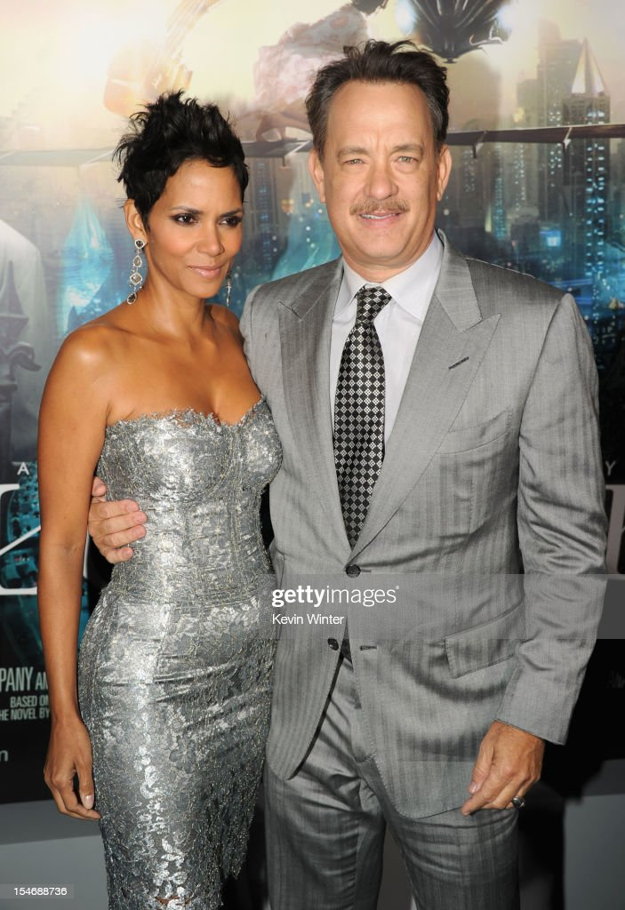 Actors <a gi-track='captionPersonalityLinkClicked' href=/galleries/search?phrase=Halle+Berry&family=editorial&specificpeople=201726 ng-click='$event.stopPropagation()'>Halle Berry</a> and <a gi-track='captionPersonalityLinkClicked' href=/galleries/search?phrase=Tom+Hanks&family=editorial&specificpeople=201790 ng-click='$event.stopPropagation()'>Tom Hanks</a> arrive at Warner Bros. Pictures' 'Cloud Atlas' premiere at Grauman's Chinese Theatre on October 24, 2012 in Hollywood, California.