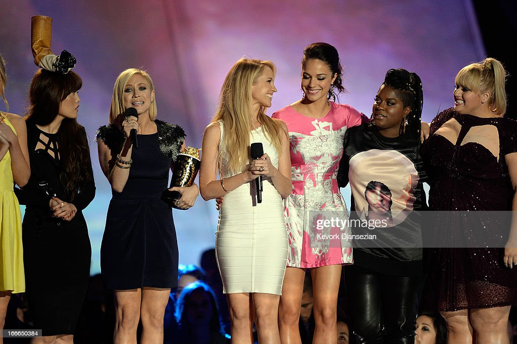 Actors Hana Mae Lee, Brittany Snow, Anna Camp, Alexis Knapp, Ester Dean, and Rebel Wilson accept the award for Best Musical Moment onstage during the 2013 MTV Movie Awards at Sony Pictures Studios on April 14, 2013 in Culver City, California.