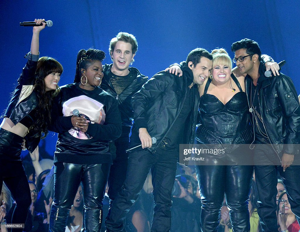 Actors Hana Mae Lee, Ester Dean, Ben Platt, <a gi-track='captionPersonalityLinkClicked' href=/galleries/search?phrase=Skylar+Astin&family=editorial&specificpeople=4463360 ng-click='$event.stopPropagation()'>Skylar Astin</a>, <a gi-track='captionPersonalityLinkClicked' href=/galleries/search?phrase=Rebel+Wilson&family=editorial&specificpeople=5563104 ng-click='$event.stopPropagation()'>Rebel Wilson</a>, and Utkarsh Ambudkar perform onstage during the 2013 MTV Movie Awards at Sony Pictures Studios on April 14, 2013 in Culver City, California.