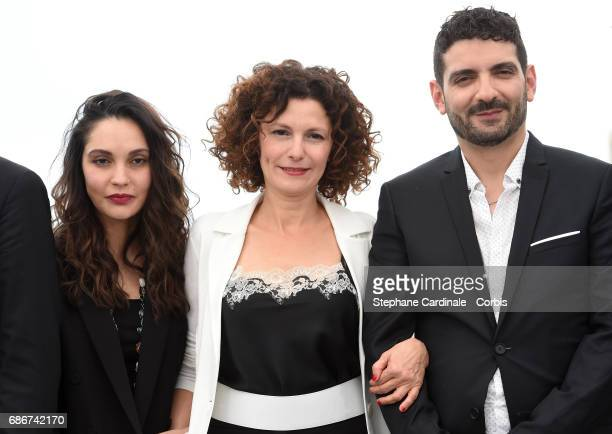 Actors Hania Amar Nadia Kaci and director Karim Moussaoui attend 'Waiting For Swallows ' photocall during the 70th annual Cannes Film Festival at...