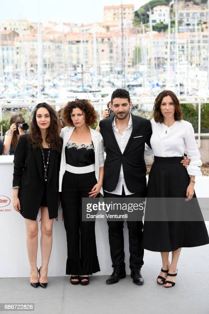 Actors Hania Amar Nadia Kaci Karim Moussaoui and Aure Atika attend 'Waiting For Swallows ' photocall during the 70th annual Cannes Film Festival at...