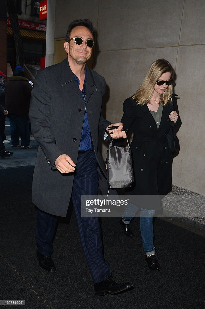 Actors Hank Azaria (L) and Katie Wright enter the 'Today Show' taping at the NBC Rockefeller Center Studios on January 15, 2014 in New York City.