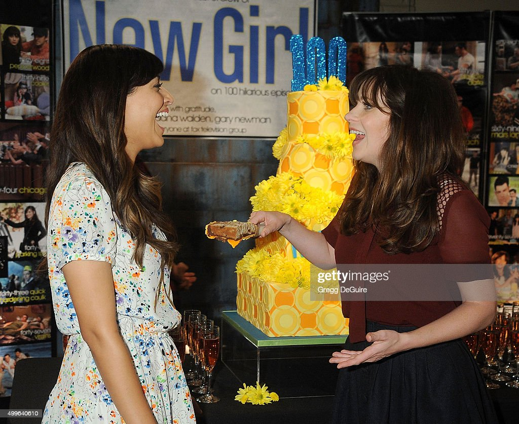 Actors Hannah Simone and Zooey Deschanel attend FOX's 'New Girl' 100th Episode Cake-Cutting at Fox Studio Lot on December 2, 2015 in Century City, California.