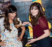 Actors Hannah Simone and Zooey Deschanel attend FOX's 'New Girl' 100th Episode Cake Cutting' held at Fox Studio Lot on December 2 2015 in Century...