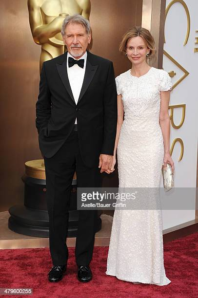 Actors Harrison Ford and Calista Flockhart arrive at the 86th Annual Academy Awards at Hollywood Highland Center on March 2 2014 in Hollywood...