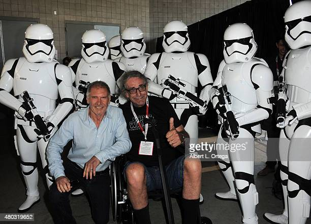 Actors Harrison Ford and Peter Mayhew pose with Stormtroopers backstage at the Lucasfilm panel during ComicCon International 2015 at the San Diego...