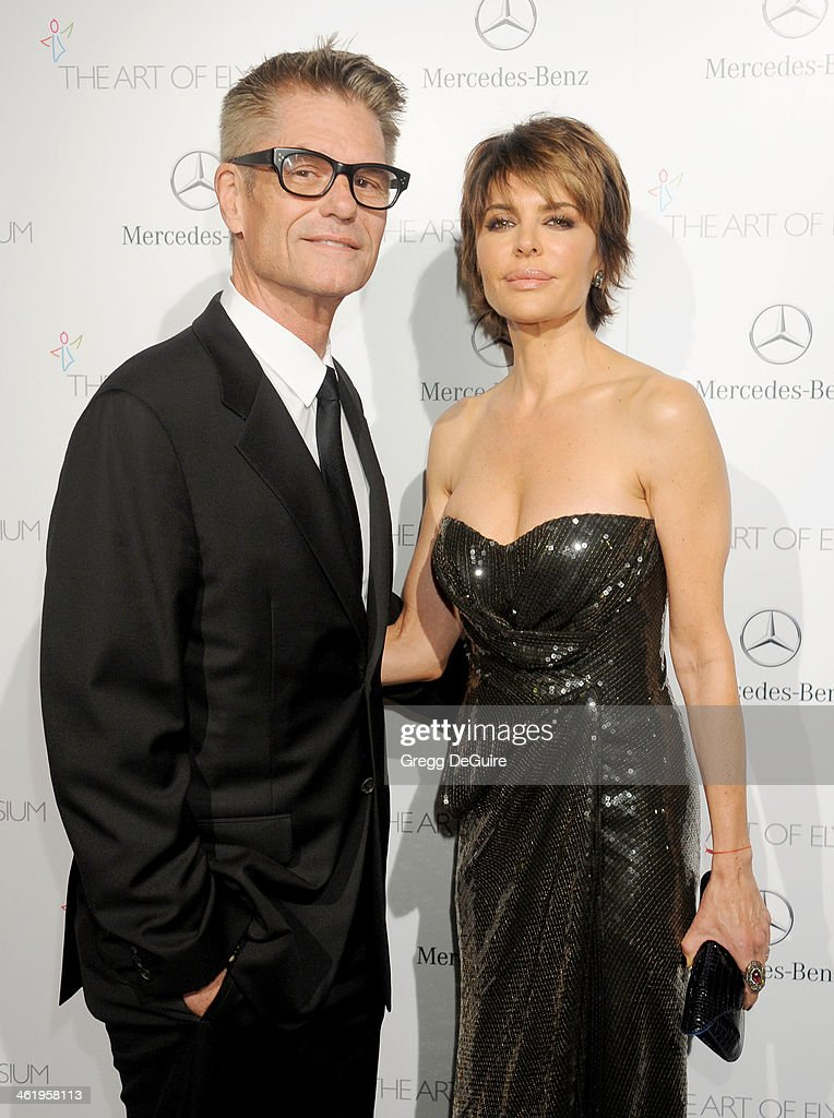 Actors <a gi-track='captionPersonalityLinkClicked' href=/galleries/search?phrase=Harry+Hamlin&family=editorial&specificpeople=211584 ng-click='$event.stopPropagation()'>Harry Hamlin</a> and <a gi-track='captionPersonalityLinkClicked' href=/galleries/search?phrase=Lisa+Rinna&family=editorial&specificpeople=202100 ng-click='$event.stopPropagation()'>Lisa Rinna</a> arrive at The Art of Elysium's 7th Annual HEAVEN Gala at the Guerin Pavilion at the Skirball Cultural Center on January 11, 2014 in Los Angeles, California.