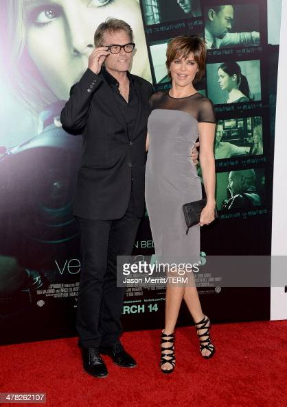 Actors Harry Hamlin and Lisa Rinna arrive at the Los Angeles premiere of 'Veronica Mars' at TCL Chinese Theatre on March 12 2014 in Hollywood...