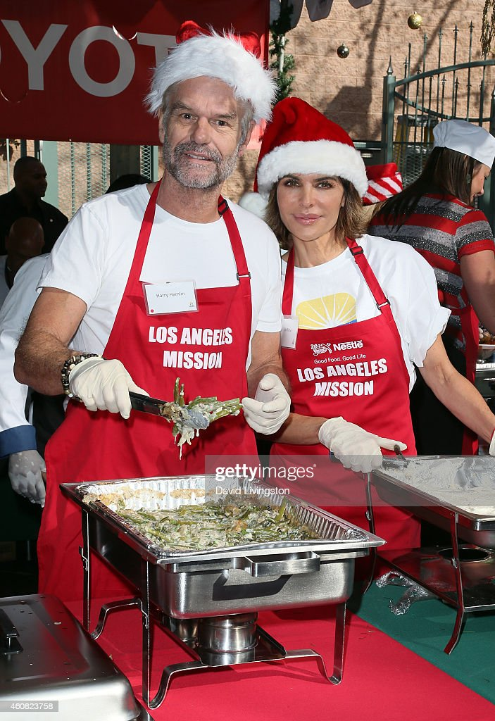 Actors Harry Hamlin (L) and Lisa Rinna attend the Los Angeles Mission Christmas Eve Event for skid row homeless at the Los Angeles Mission on December 24, 2014 in Los Angeles, California.