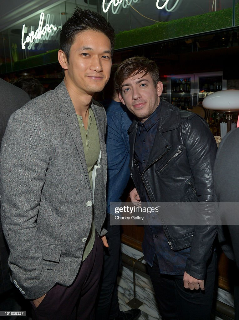 Actors Harry Shum Jr. (L) and Kevin McHale wearing Topman attend the Topshop Topman LA Opening Party at Cecconi's West Hollywood on February 13, 2013 in Los Angeles, California.