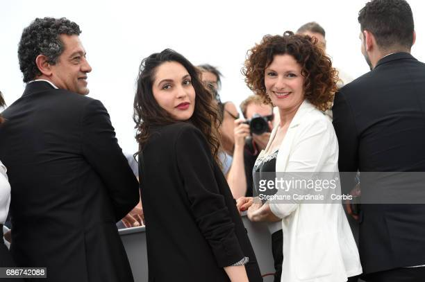 Actors Hassan Kachach Hania Amar Nadia Kaci and director Karim Moussaoui attend 'Waiting For Swallows ' photocall during the 70th annual Cannes Film...