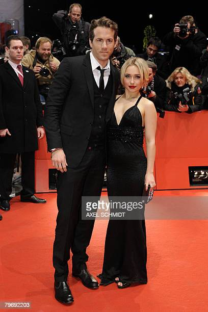 US actors Hayden Panettiere and Ryan Reynolds pose for photographers as they arrive on the red carpet for the screening of the film 'Fireflies In The...