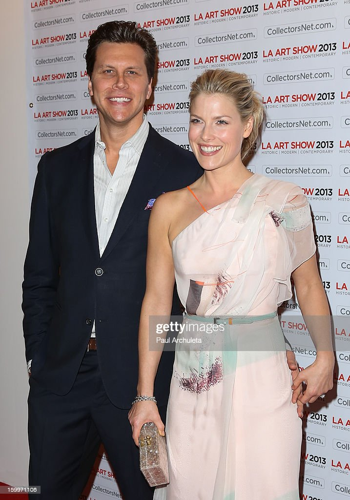 Actors Hayes MacArthur (L) and Ali Larter (R) attend the LA Art Show opening night party at Los Angeles Convention Center on January 23, 2013 in Los Angeles, California.