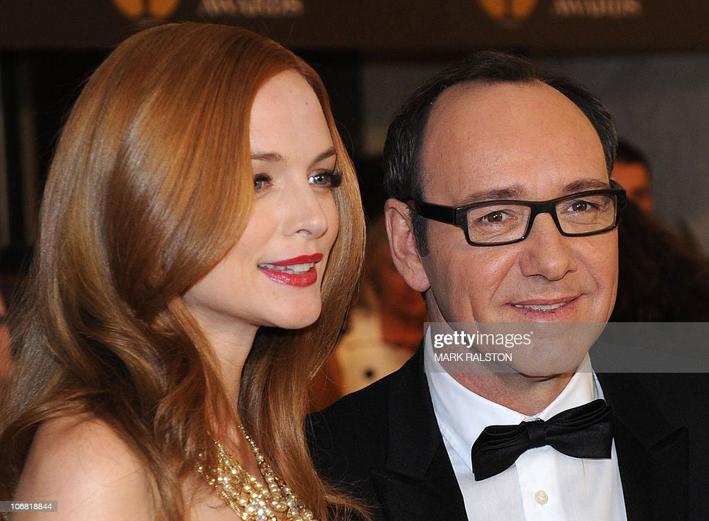 Actors Heather Graham and Kevin Spacey arrive on the red carpet for the 2010 Oscars Governors Awards at the Hollywood and Highland Center in Hollywood on November 13, 2010. AFP PHOTO/Mark RALSTON
